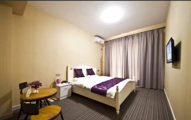 福州长乐国际机场旁民宿(免费接送机)——紫色情迷豪华大床房