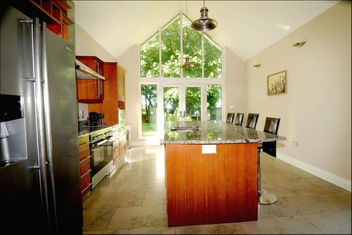 Kitchen from Dining Rooms