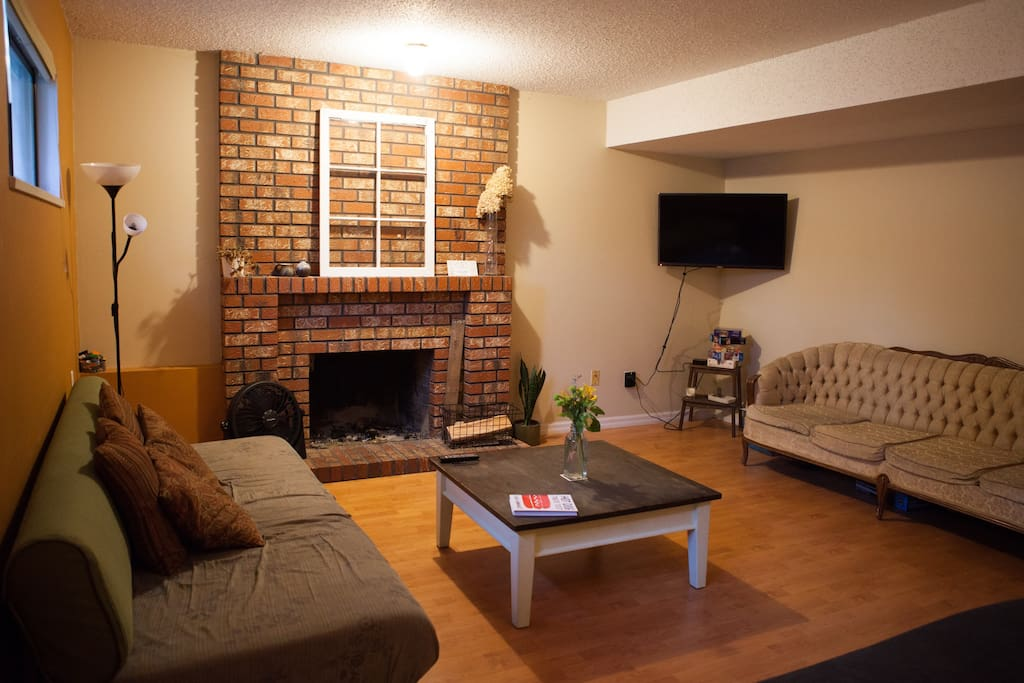 Shared living room - wood fireplace and tv with access to Netflix & Crave TV