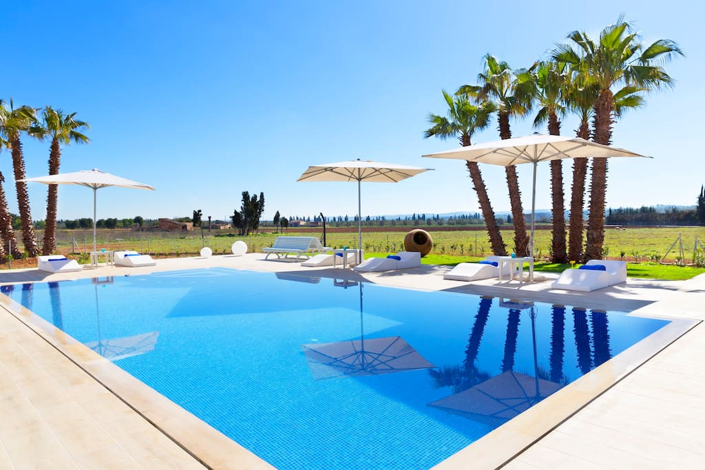 Pool with sun beds and parasol