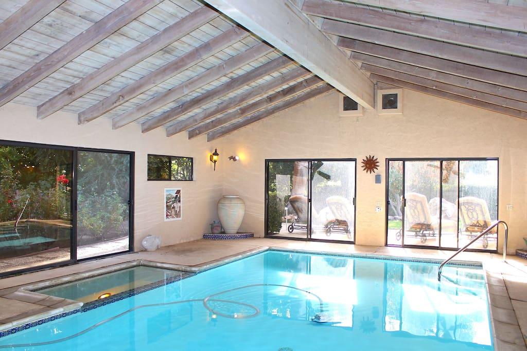 The pool area has an indoor heated pool with spa and lots of seating