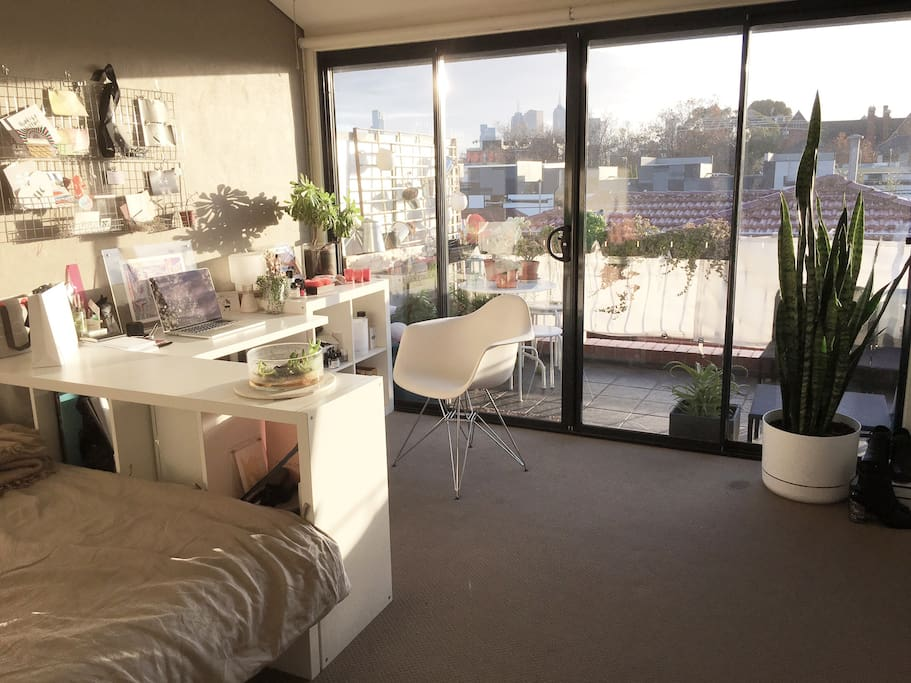 Sunny bedroom with view on the city