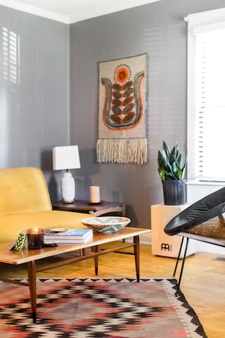 Creative living room space with collected midcentury pieces and art.