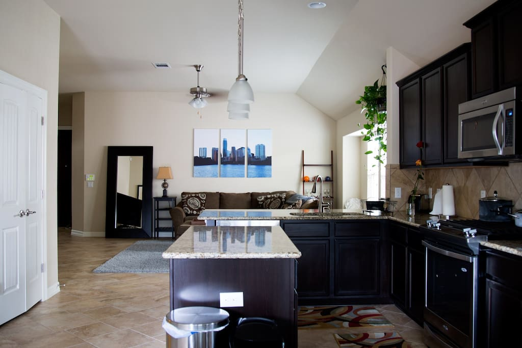 Spacious, open concept kitchen with new whirlpool appliances.