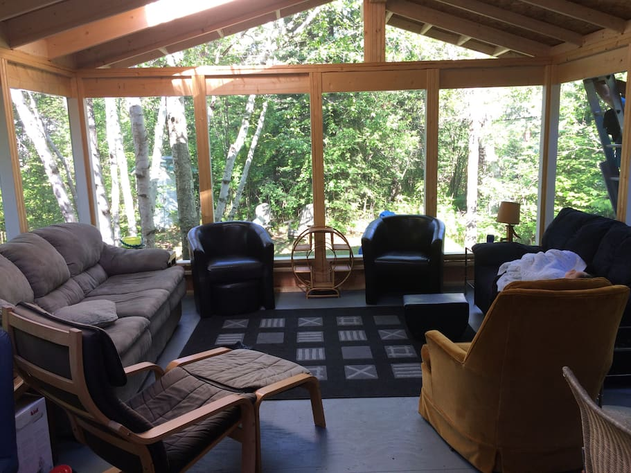 Large screened in veranda, complete with skylights, facing the backyard.