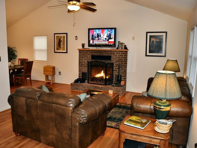 Spacious living room with large fireplace and flat screen, hi-def TV