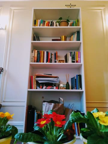 Books and other belongings stay in the apartment