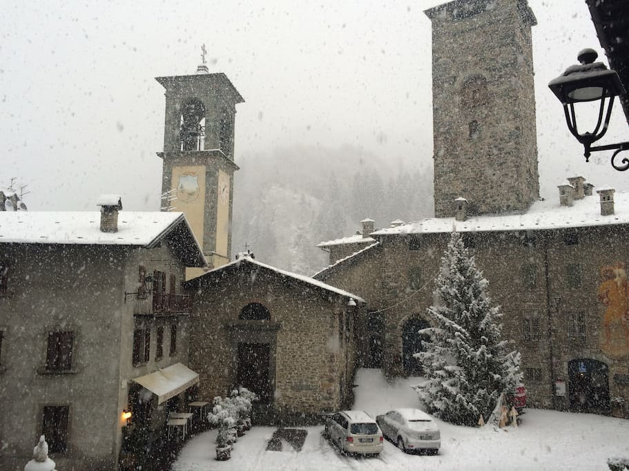 View from the apartment on the piazza: the church and the castle (now hosting a restaurant and a bar-cafeteria
