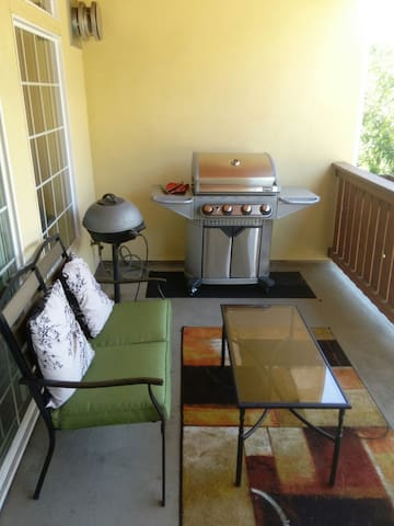 comfy balcony with gas and electric grills