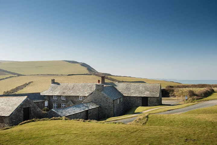A Cornish farmhouse tucked into the cliffs with amazing views.  You can see High Cliff in the background!
