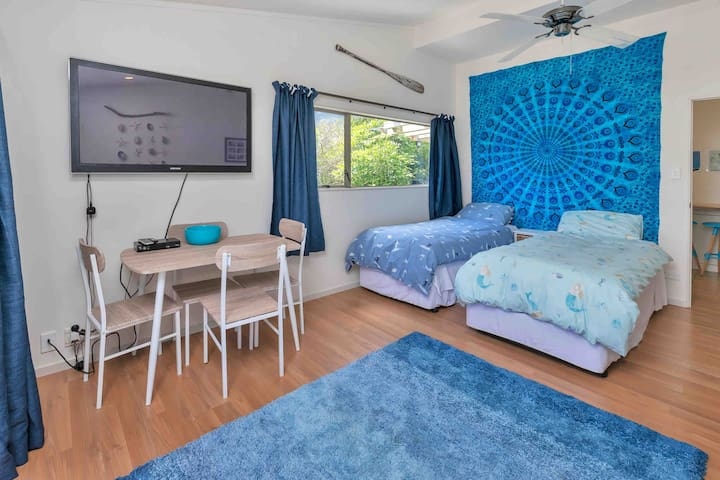 The Beach Room with two single beds (that can be made into a super king as requested). Dining area and 50 inch TV with smartview