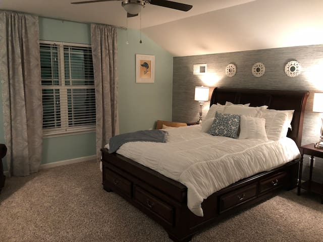 Enjoy sleeping in in your private bedroom with blackout curtains which adjoins the private sitting room.  The queen bed has a comfy pillow top mattress and linens!