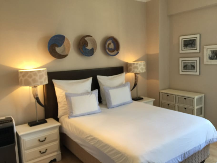 Stylish bedroom with comfy bed with white linen and block out curtains Extra single bed which we can  move into the lounge.