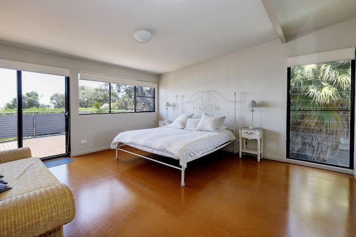 The Master bedroom has an ensuite and looks north over the ocean towards Port Macquarie.