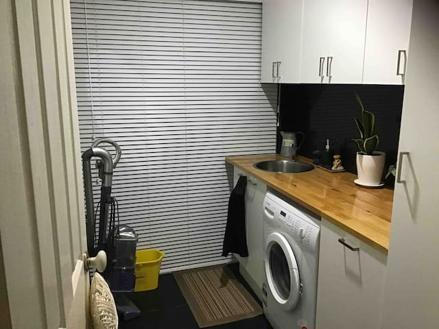 Laundry with toilet for guests.