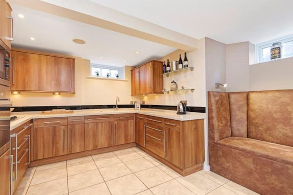 Spacious kitchen with new leather booth