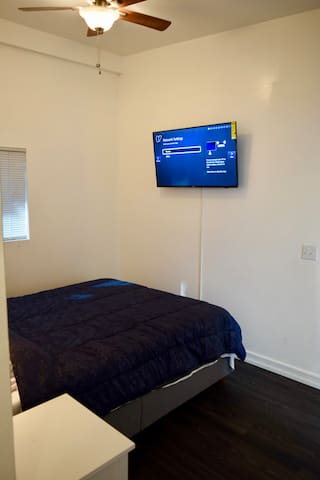 """Bedroom off living room with queen bed and 42"""" smart tv to access your favorite entertainment apps"""