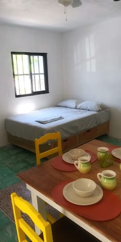 Matrimonial bed and eating area