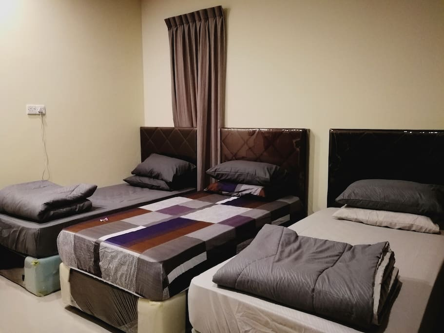 3 Single Beds in one room. Best options for travelers with group of friends or family.