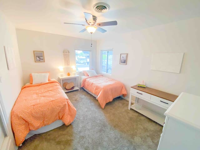 Third bedroom with a spacious closet and two twin beds. They have memory foam toppers that can be pushed together to form a king bed.