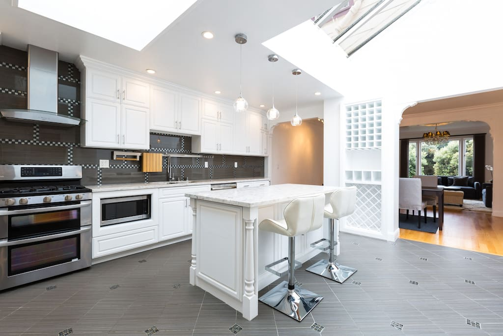 Modern Kitchen with all brand new appliances Microwave, Stove, Dishwasher, Fridge, Coffee Maker, Toaster