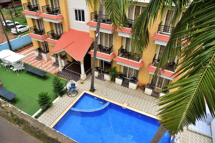 Luxury superior poolfacing room at Central Baga CP