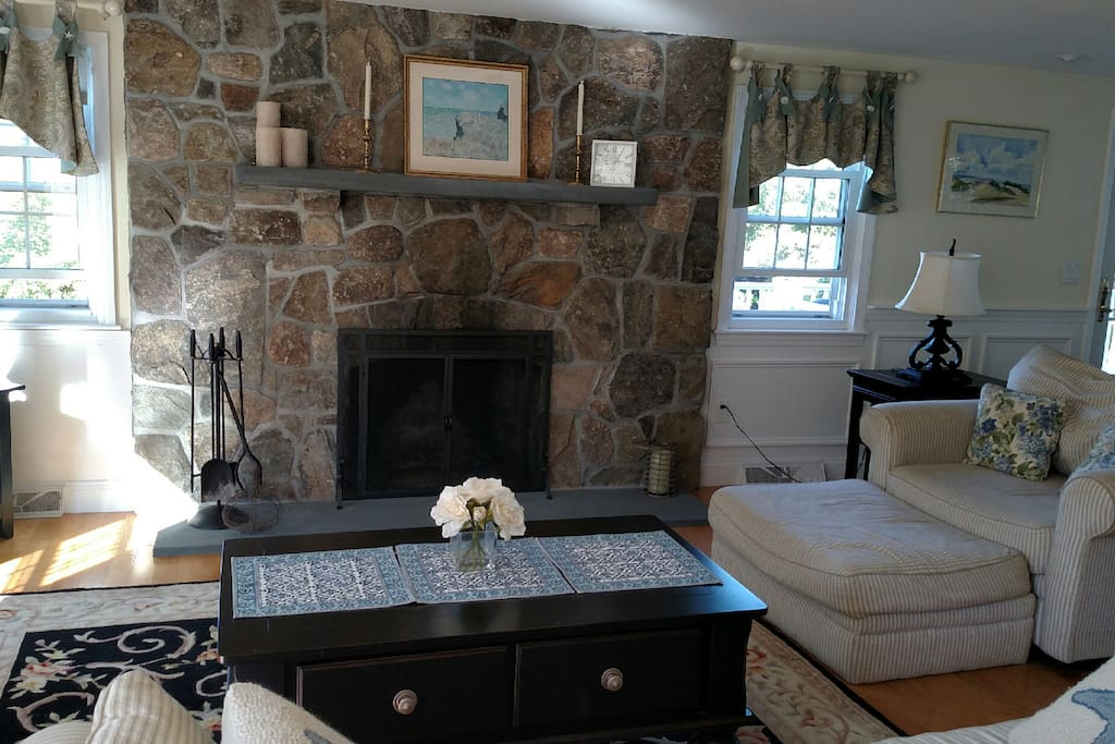 Floor to ceiling flagstone fireplace in living room.