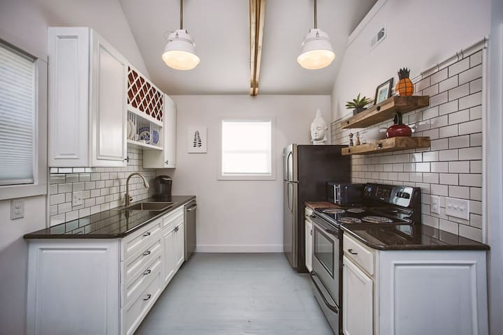Fully stocked kitchen with coffee and maker