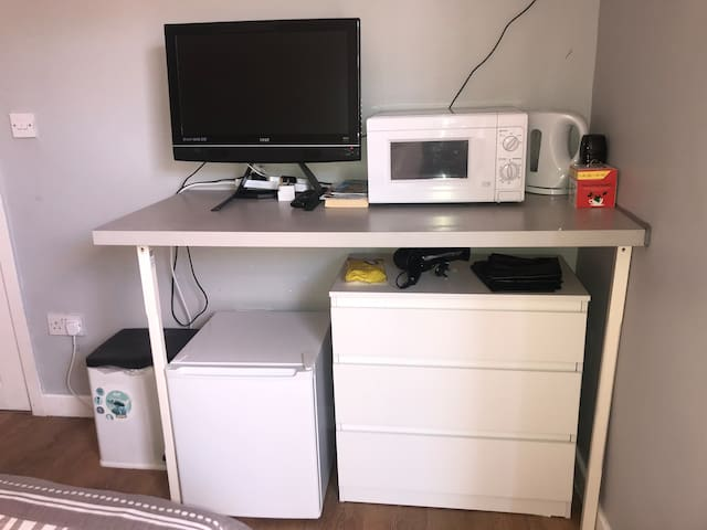 Freeview TV with DVD player. Fridge, Microwave, kettle and chest of drawers.