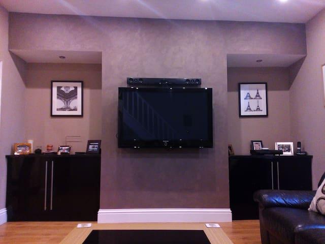 Large plasma TV with sound bar, TiVo and Xbox