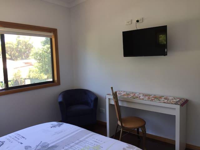 TV/Computer desk in room