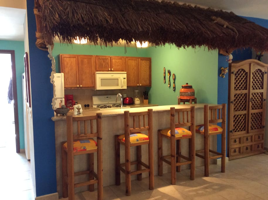 Breakfast bar with fun palapa. Kitchen is fully equipped including dishwasher.
