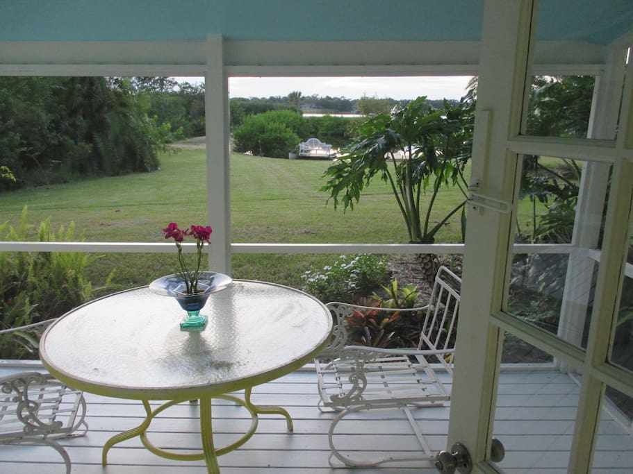 Eat in or out on the screened porch over looking the Sebastian River.