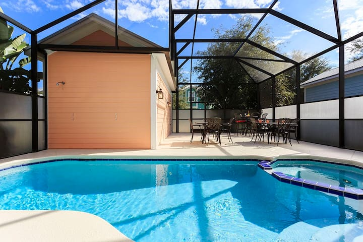 Relax by the east facing screened in pool deck and spa