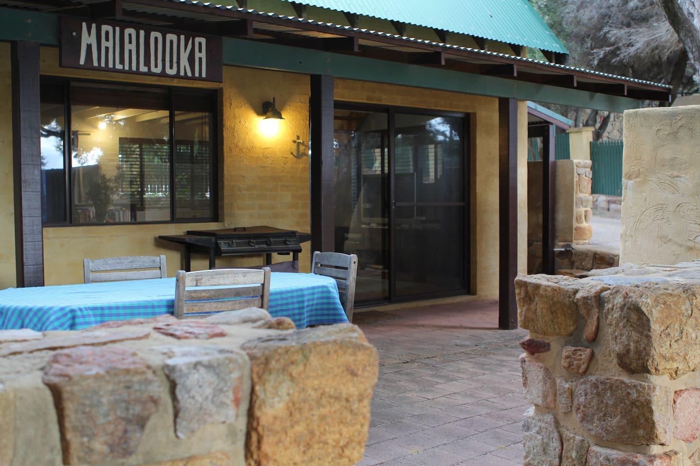 Front courtyard with BBQ, outdoor seating, shade and gorgeous feel.