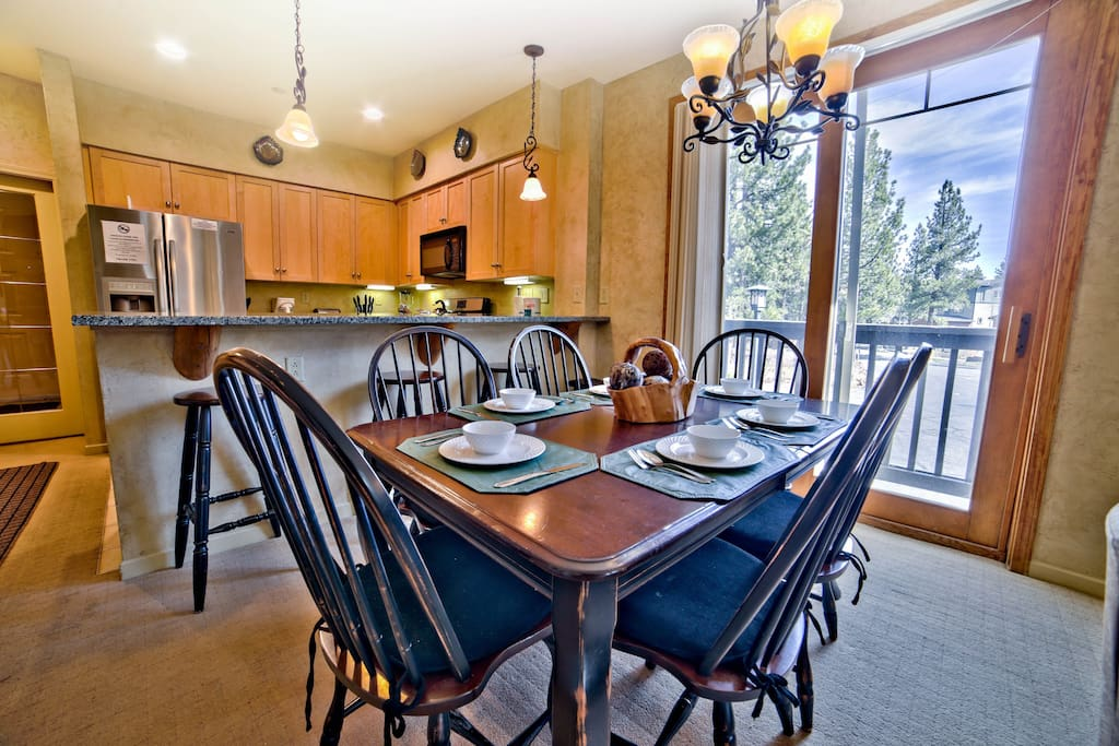 Dining Area with large slider opening to forest views