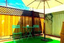 private patio off kitchen with bistro