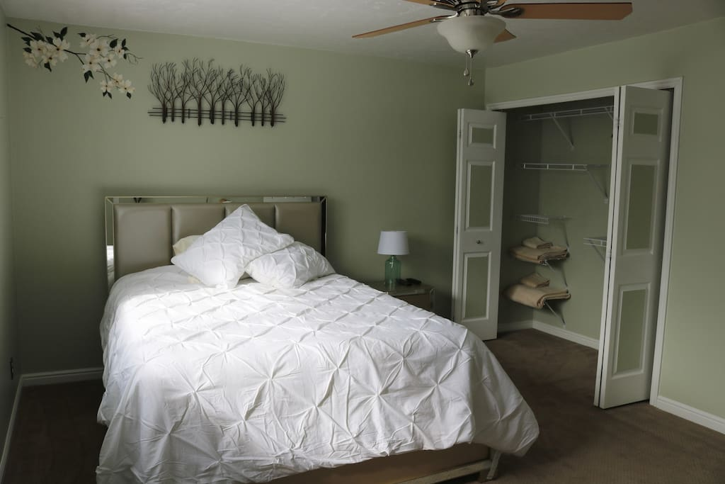 """The Master bedroom includes a queen sized bed a 40 """" TV with Xfinity and a private bathroom."""