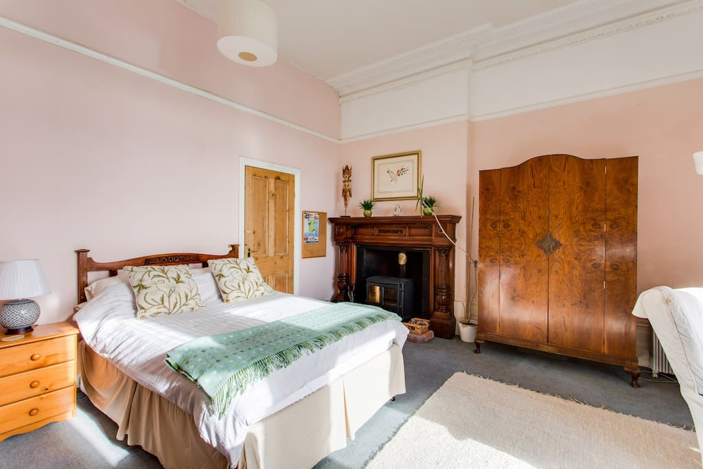 Antique bed, wardrobe and period fireplace
