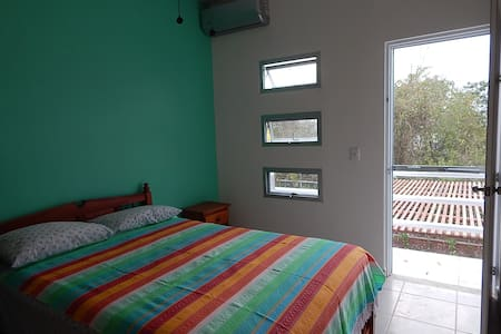Clean and quiet bedroom with balcony