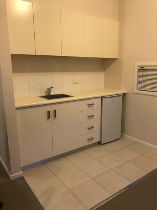 Kitchenette with microwave, and convection oven for guests to use