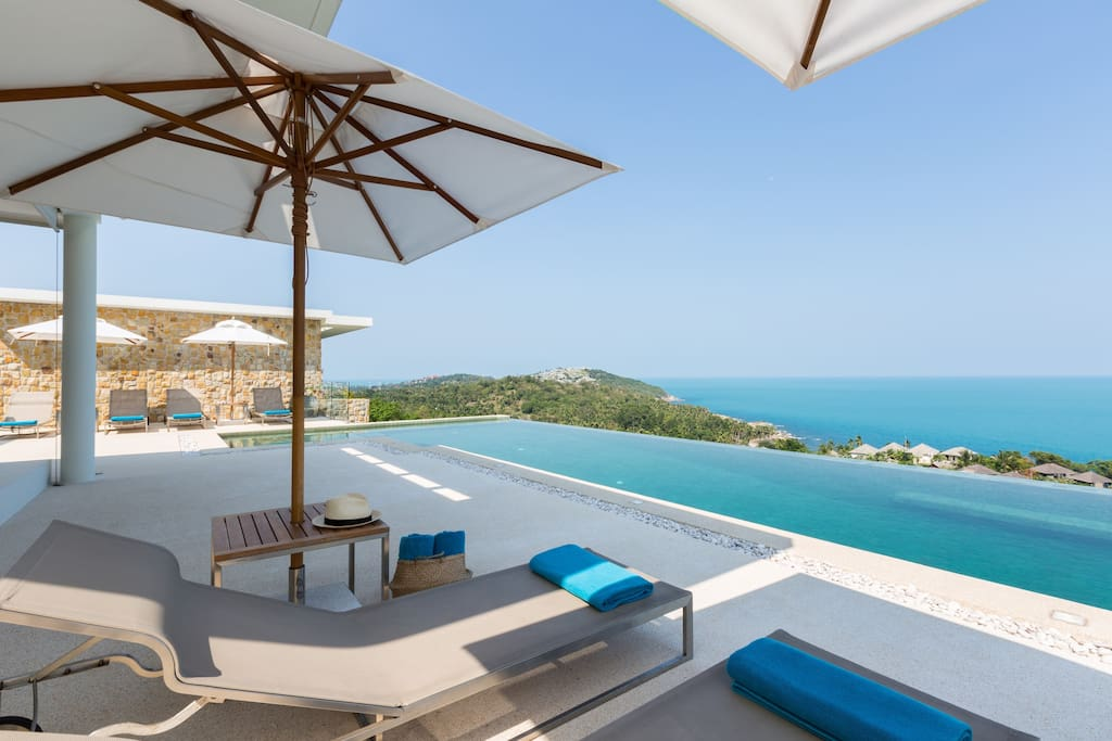 Relax near the swimming pool with our unique sea view