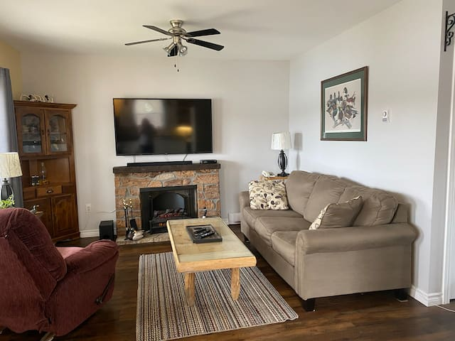 """Open concept living room with 55"""" Tv"""