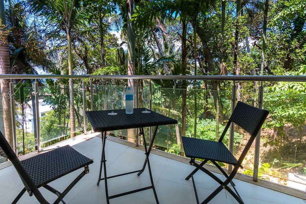 Balcony with a view to the jungle and a small view to Karon Beach.