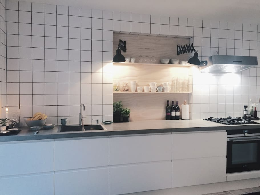 The kitchen fully equipped with everything you need for dining in.