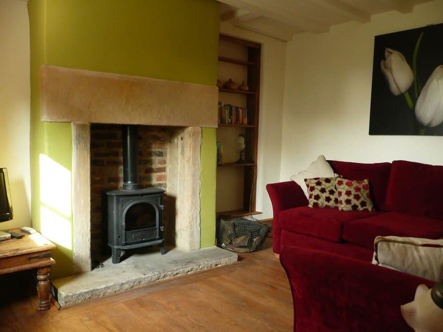 Cosy comfortable lounge with wood burning stove