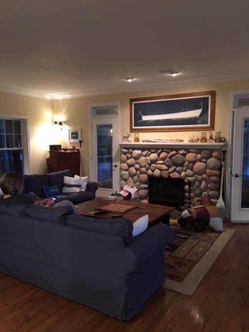 Gorgeous stone fireplace is the focal point of the living room