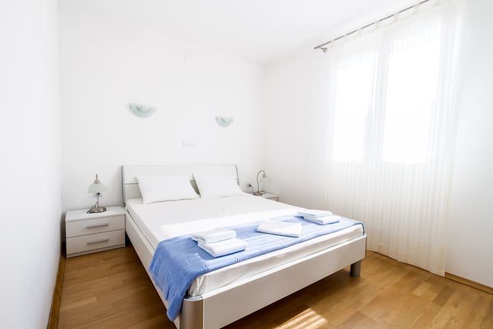 Bright and spacious bedroom with a double bed for two person