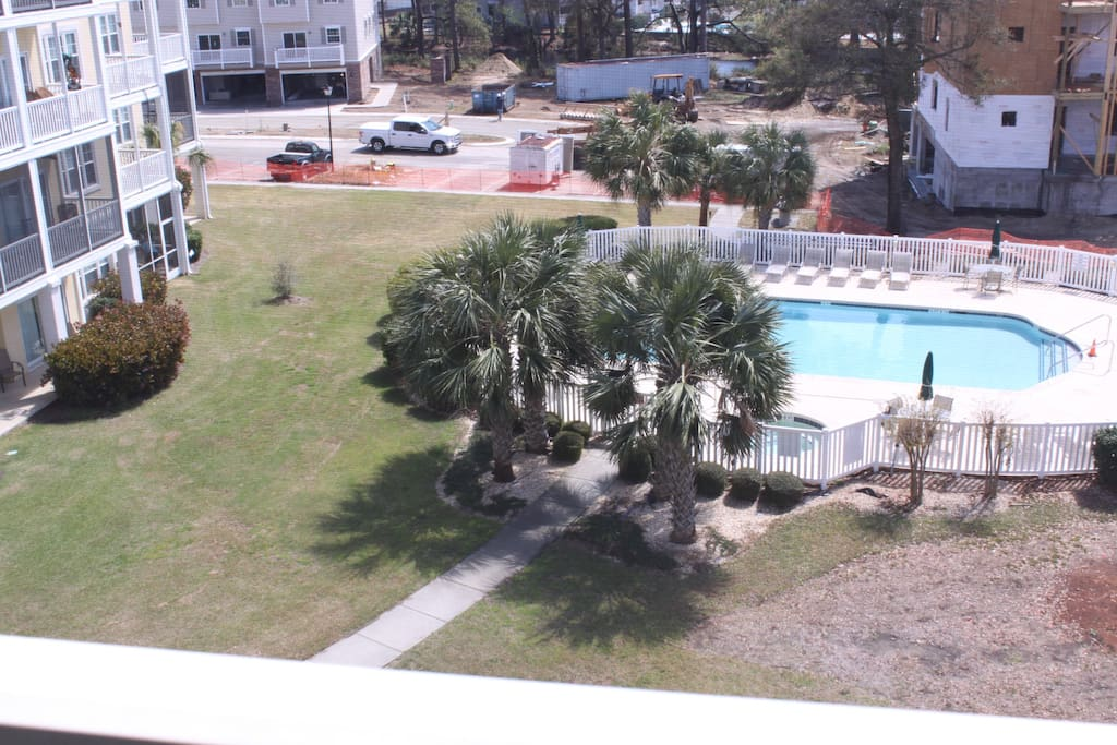 View of pool from porch