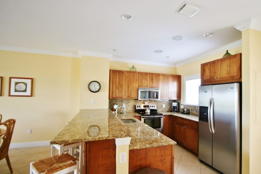 The Gourmet Kitchen Features Modern Stainless Steel Appliances and Granite Countertops  Florida Keys Vacation Rental